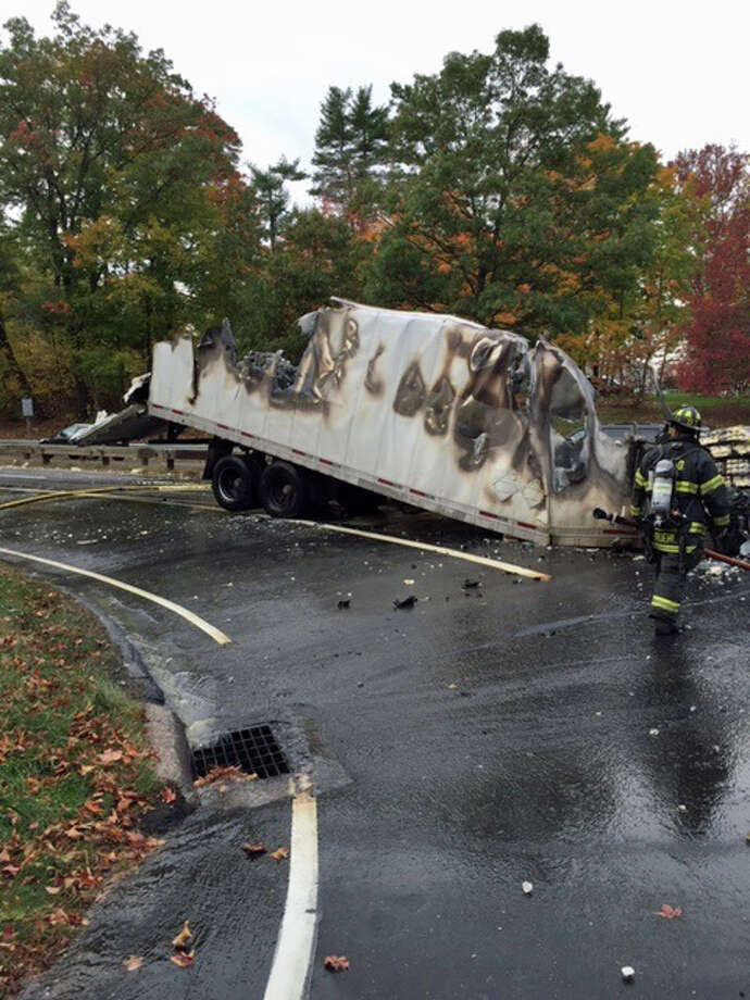 Fire ate through a truck carrying butter after it crashed on the Merritt Tuesday. Photo: Contributed Photo / Greenwich Time Contributed
