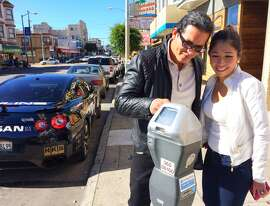 Richard Gutierrez of Hayward and his fiancée Sarinya Nanthasiri weren't sure whether to pay for parking Sunday because the meters in San Francisco contain conflicting information. Gutierrez was dropping Nanthasiri off for lunch at Burma Superstar on Clement Street.