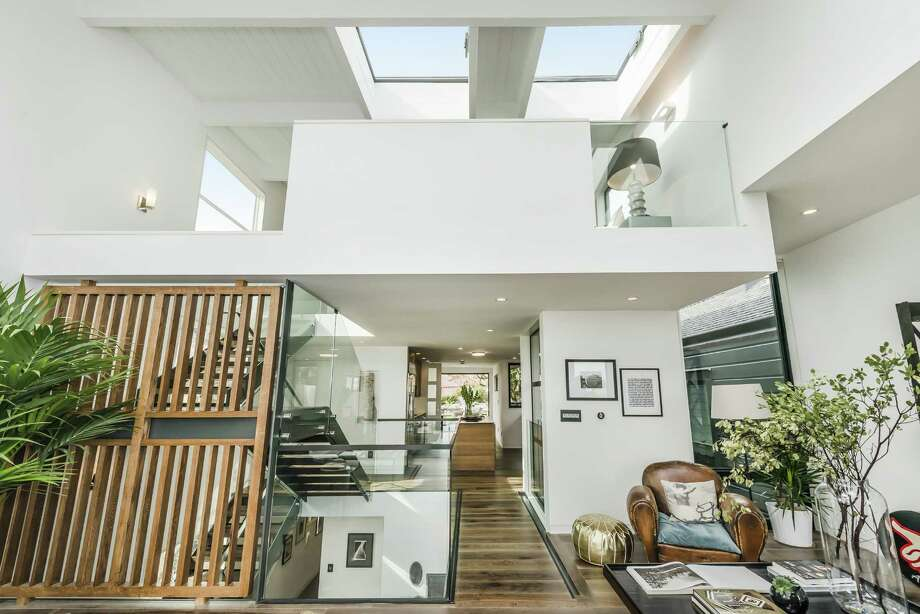 Two skylights welcome natural light into the great room. Photo: Olga Soboleva/Vanguard Propertie / ONLINE_CHECK