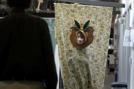 Paige Russell greets coworkers while wearing her wall-mounted taxidermed jackalope Halloween costume at Autodesk's Pier 9 workshop in San Francisco, Calif. on Wednesday, Oct. 29, 2014.