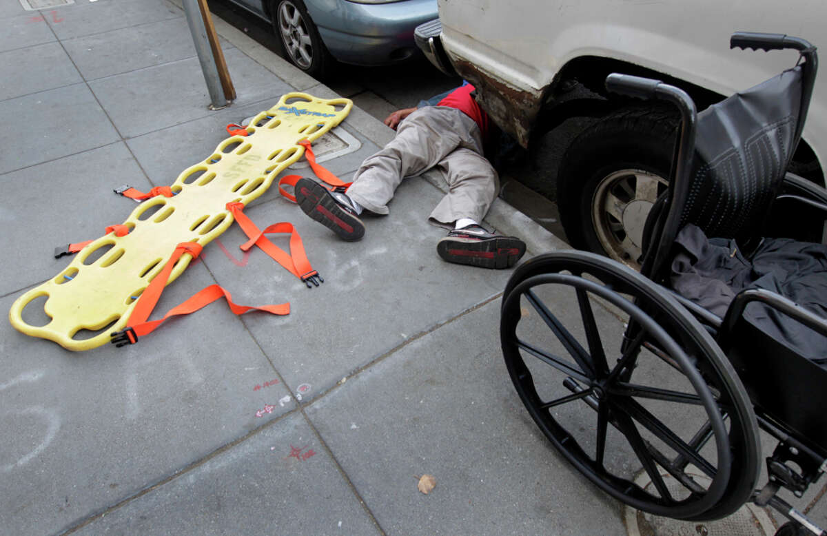 Fire Engine 1 responded to a report of a man on Sixth Street in San Francisco who passed out and fell from his wheelchair into the gutter on Oct. 22, 2014.