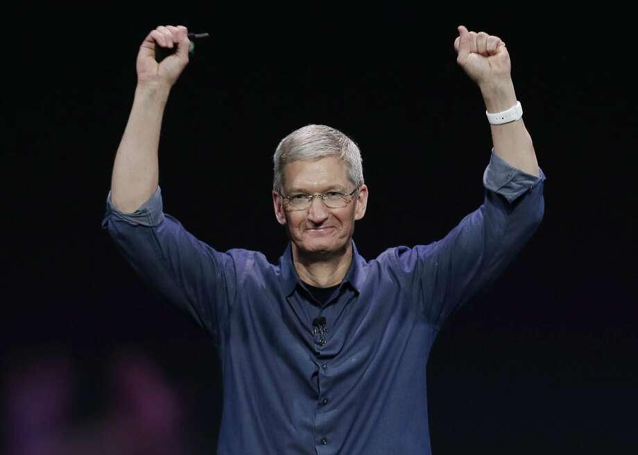 FILE - In this Sept. 9, 2014, file photo, Apple CEO Tim Cook introduces Apple Watch, which he is wearing on his wrist in Cupertino, Calif. Apple Inc. is expected to unveil new iPads at an event Thursday, Oct. 16 as the company tries to drive excitement amid slowing demand for tablet computers. (AP Photo/Marcio Jose Sanchez, File) Photo: Marcio Jose Sanchez, Associated Press