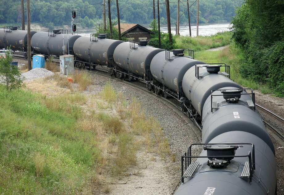 A train carries crude oil through Kansas City, Mo., in 2014. Environmentalist Tom Steyer's NextGen Climate organization warns that railcars carrying oil from Canada could soon hit West Coast refineries. Photo: Curtis Tate, McClatchy-Tribune News Service