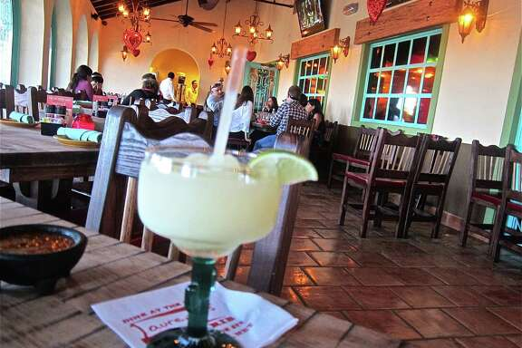 A dining porch at the new El Tiempo on Navigation. Photo by Alison Cook