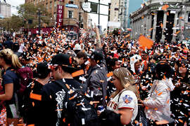 Fans party during the parade that followed the Giants' 2012 World Series Championship on Oct. 31, 2012, in San Francisco.