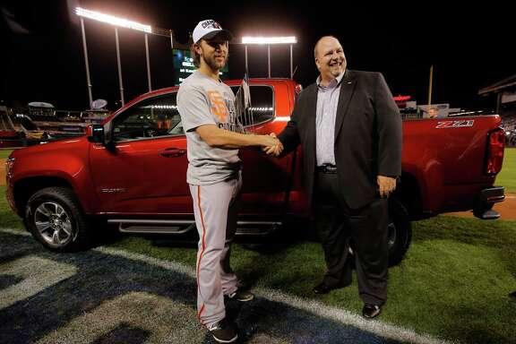The Giants' Madison Bumgarner, World Series MVP, shakes hands with Chevrolet's Rikk Wilde, whose blooper got him national attention.
