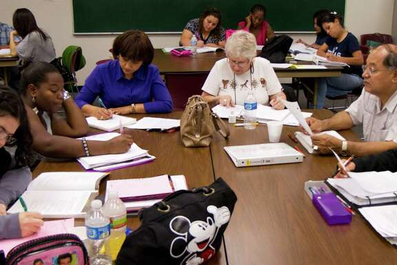 Students work on an assignment during a GED class at the Harris County Department of Education Adult Learning Center on Wednesday, Sept. 14, 2011, in Houston.  The HCDE offers both GED and ESL classes to over 10,000 students at over 60 sites throughout Houston. ( Andrew Richardson / Houston Chronicle )