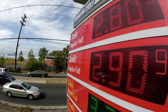 Gasoline prices below $3 are displayed at a gas station earlier this month in  Jersey City, N.J.