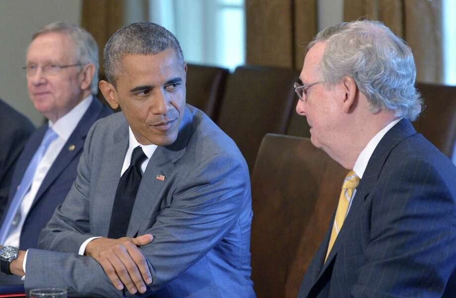 Presidnet Barack Obama may have the worst job in the world if Senate Republican Leader Mitch McConnell becomes majority leader. Photo: MANDEL NGAN / MANDEL NGAN / AFP/Getty Images / AFP