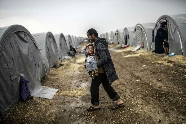 Small Iraqi peshmerga force enters Syrian town