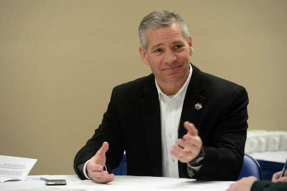 TransCanada CEO Russ Girling talk before an event  in Beaumont in , February 2014. (Photo:  Guiseppe Barranco/ Beaumont Enterprise)
