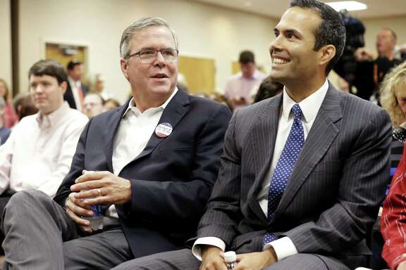 Jeb Bush, left, who appeared with his son, Texas Land Commissioner George P. Bush, during last fall's campaign, has moderated his rhetoric and in some cases his stand on issues as he prepares for a possible run for the presidency.