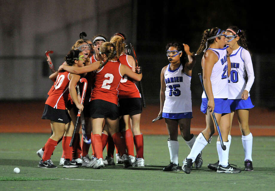 The New Canaan team celebrates after their team mate Isabel Taben scored her second goal on Darien during their FCIAC field hockey championship game at Brien McMahon High School in Norwalk, Conn., on Thursday, Oct. 30, 2014. New Canaan took home the title beating Darien, 2-0. Photo: Jason Rearick / Stamford Advocate