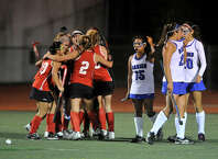 The New Canaan team celebrates after their team mate Isabel Taben scored her second goal on Darien during their FCIAC field hockey championship game at Brien McMahon High School in Norwalk, Conn., on Thursday, Oct. 30, 2014. New Canaan took home the title beating Darien, 2-0.