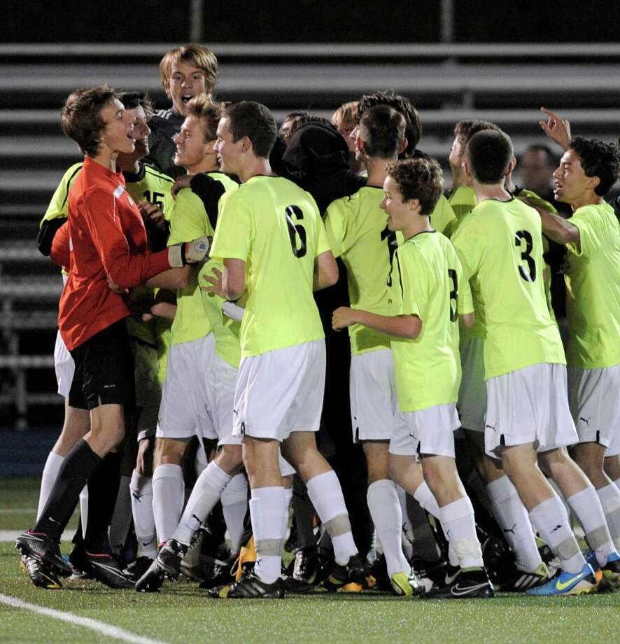 Joel Barlow celebrates after winning the SWC boys soccer championship game against Bethel, 1-0, on Thursday night, October 30, 2014, at Newtown High School, Newtown, Conn. Photo: H John Voorhees III / The News-Times Staff Photographer