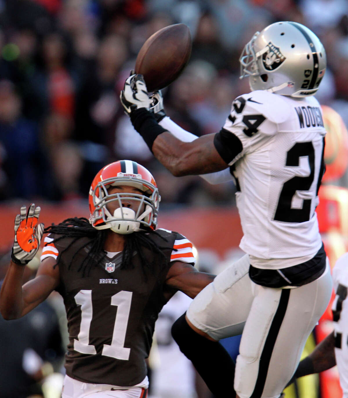 Charles Woodson nearly intercepts a pass in Cleveland. Woodson has two picks this season.