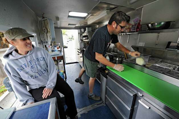 Andrea Loguidice and her boyfriend Brandon Snooks, both of Schenectady, work on the Wandering Dago food truck outside Schenectady County Public Library Tuesday, Oct. 9, 2012 in Schenectady, N.Y. (Lori Van Buren / Times Union) Photo: Lori Van Buren / 00019582A