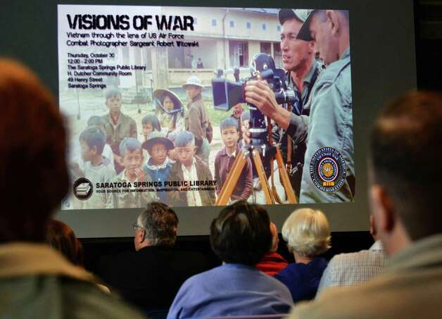 """""""Visions of War,"""" an examination of the Vietnam War through the work of the late U.S. Air Force combat photographer Sgt. Robert Witowski presented at the Saratoga Springs Library Thursday Oct. 30, 2014, in Saratoga Springs, NY.  (John Carl D'Annibale / Times Union) Photo: John Carl D'Annibale / 00029258A"""