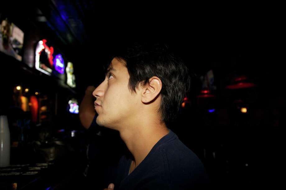 Jay Flores watches the Cowboys. Photo: Xelina Flores / Xelina Flores / / For the Express News