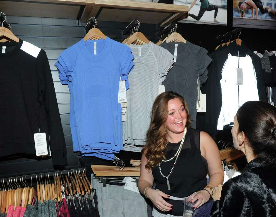 At left, Jackie Fahey, Lululemon store manager, helps a customer during the re-opening of the Lululemon store at 151 Greenwich Ave., Greenwich, Conn., Thursday, Oct. 30, 2014. Lululemon sells athletic apparel and accessories for women, men, and female youth. Photo: Bob Luckey / Greenwich Time