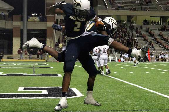 Cy Ranch's RJ Sneed II (2) celebrates one of his touchdowns during the second half of action between Cy-Fair and Cy Ranch high schools during a football game at the Berry Center, Thursday, Oct. 30, 2014, in Houston. Cy Ranch won the game 38-21.