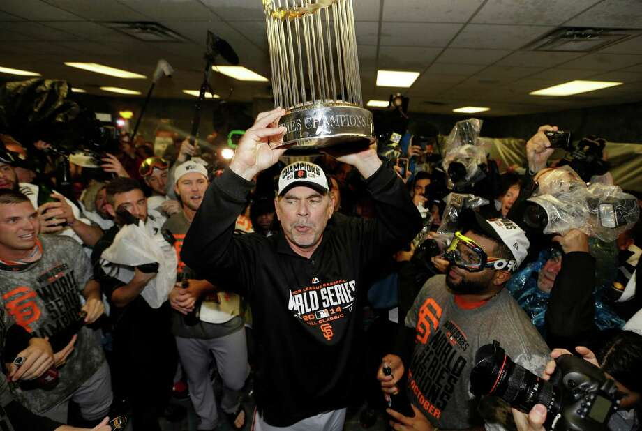 San Francisco Giants manager Bruce Bochy celebrates after Game 7 of baseball's World Series against the Kansas City Royals, Wednesday, Oct. 29, 2014, in Kansas City, Mo. The Giants won 3-2 to win the series. (AP Photo/David J. Phillip) Photo: David J. Phillip, STF / AP