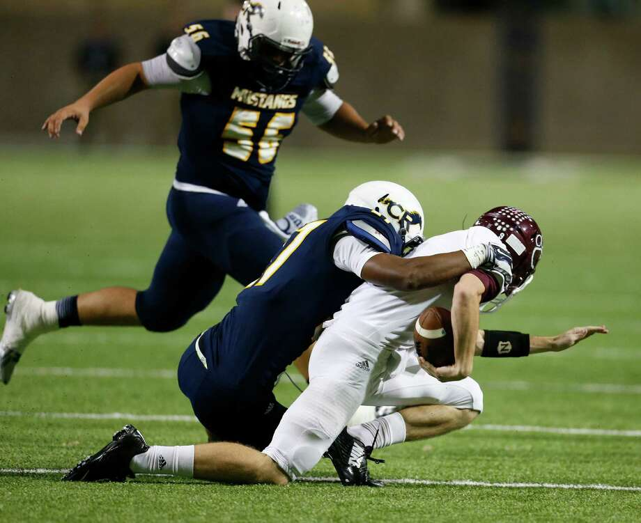 Cy-Fair's QB Conner Crawford (9) is brought down by Cy Ranch's Amaud Willis-Dalton (27) during the first half of action between Cy-Fair and Cy Ranch high schools during a football game at the Berry Center, Thursday, Oct. 30, 2014, in Houston.  ( Karen Warren / Houston Chronicle  ) Photo: Karen Warren, Staff / © 2014 Houston Chronicle