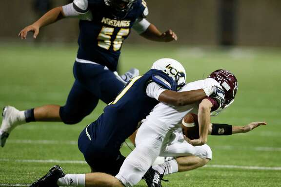 Cy-Fair's QB Conner Crawford (9) is brought down by Cy Ranch's Amaud Willis-Dalton (27) during the first half of action between Cy-Fair and Cy Ranch high schools during a football game at the Berry Center, Thursday, Oct. 30, 2014, in Houston.  ( Karen Warren / Houston Chronicle  )