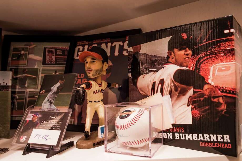 A baseball shrine at the home of Kevin Bumgarner, Madison Bumgarner's father,  in Hudson, N.C., Oct. 28, 2014. Madison Bumgarner plays for the San Francisco Giants, and on Wednesday, along with the Giants beating the Kansas City Royals, he was named the most valuable player of the World Series after recording two wins and then earning a five-inning save in Game 7. (Mike Belleme/The New York Times) Photo: MIKE BELLEME / New York Times / NYTNS