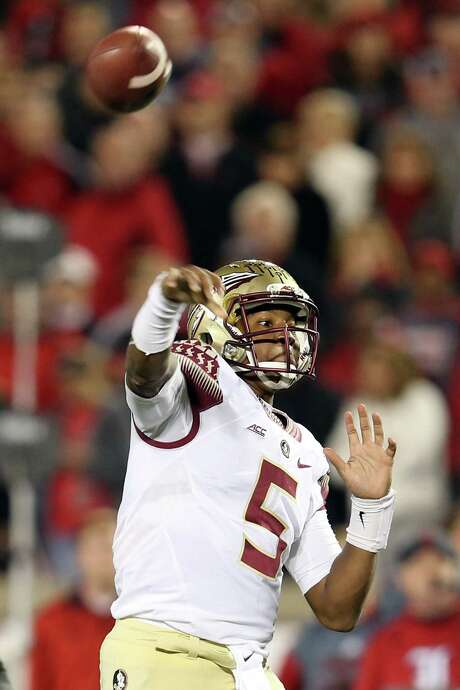 FSU QB Jameis Winston threw for 401 yards and three touchdowns against Louisville. Photo: Andy Lyons, Staff / 2014 Getty Images