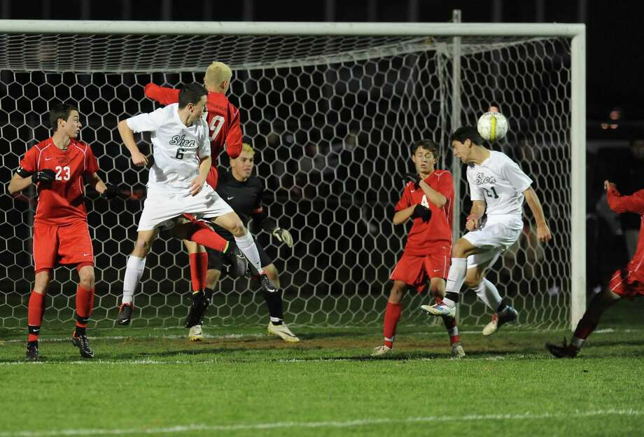 Shenendehowa's Tom Osborn, right, makes the winning and only score during the Class AA boys' semifinal soccer game against Guilderland on Thursday, Oct. 30, 2014 in Colonie, N.Y.  (Lori Van Buren / Times Union) Photo: Lori Van Buren / 00029248A
