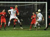 Shenendehowa's Tom Osborn, right, makes the winning and only score during the Class AA boys' semifinal soccer game against Guilderland on Thursday, Oct. 30, 2014 in Colonie, N.Y.  (Lori Van Buren / Times Union)