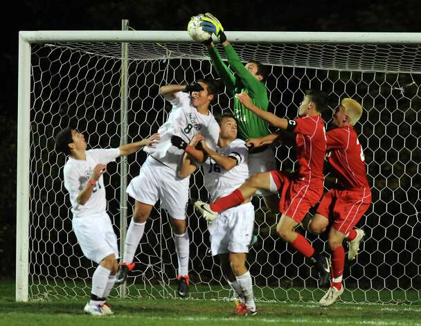 Shenendehowa goalie Jerry Lewandowski makes a save during the Class AA boys' semifinal soccer game against Guilderland on Thursday, Oct. 30, 2014 in Colonie, N.Y.  (Lori Van Buren / Times Union) Photo: Lori Van Buren / 00029248A