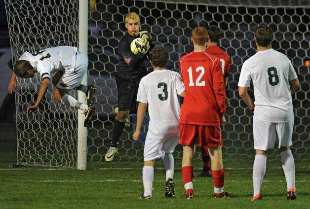 Guilderland goalie Parker Carmichael makes a save during the Class AA boys' semifinal soccer game against Shenendehowa on Thursday, Oct. 30, 2014 in Colonie, N.Y.  (Lori Van Buren / Times Union) Photo: Lori Van Buren / 00029248A