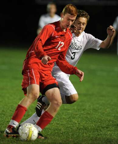 Guilderland's Chris Sour, left, battles for the ball with Shenendehowa's Michael Miner during the Class AA boys' semifinal soccer game on Thursday, Oct. 30, 2014 in Colonie, N.Y.  (Lori Van Buren / Times Union) Photo: Lori Van Buren / 00029248A