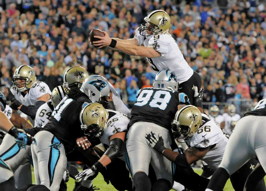 Drew Brees took matters into his own hands Thursday in leading the Saints to their first road win of the season, 28-10 over the NFC South-rival Panthers. Photo: Mike McCarn, FRE / FR34342 AP