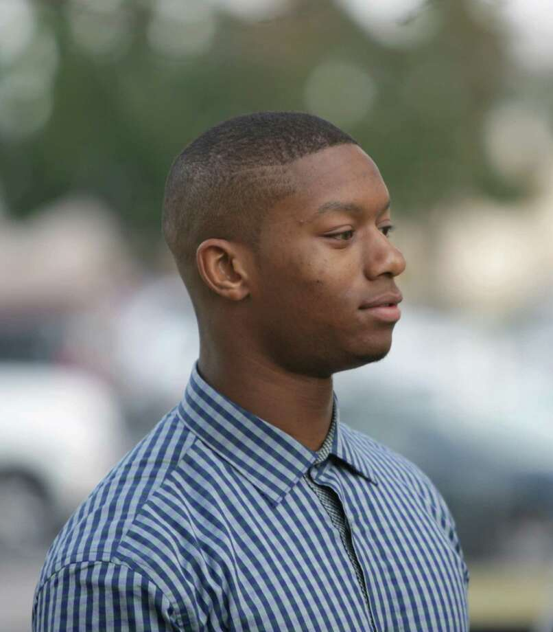 Suspended Oklahoma running back Joe Mixon leaves the Cleveland County Courthouse in Norman, Okla. Monday, Oct. 20, 2014.  (AP Photo/The Norman Transcript, Jay Chilton) Photo: Jay Chilton / The Transcript / Associated Press / The Transcript