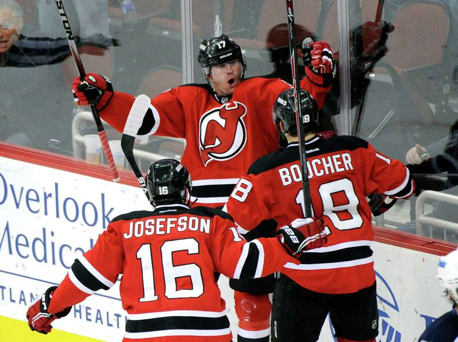 New Jersey Devils' Michael Ryder celebrates his goal with Reid Boucher (18) and Jacob Josefson (16) during the third period of an NHL hockey game against the Winnipeg Jets Thursday, Oct. 30, 2014, in Newark, N.J. The Devils won 2-1 in a shootout. (AP Photo/Bill Kostroun) Photo: Bill Kostroun / Associated Press / FR51951 AP
