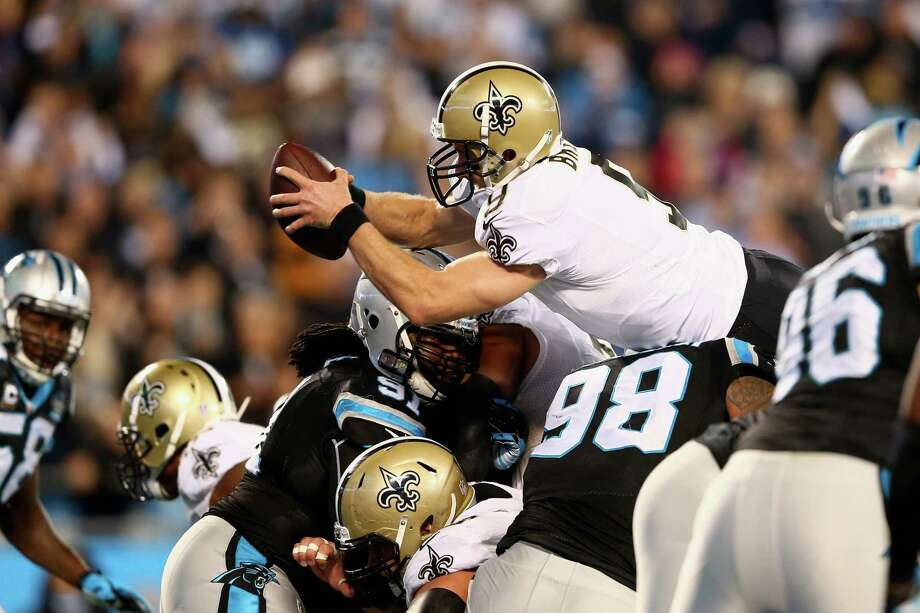 CHARLOTTE, NC - OCTOBER 30:   Drew Brees #9 of the New Orleans Saints stretches across the goal line for a touchdown against the Carolina Panthers during their game at Bank of America Stadium on October 30, 2014 in Charlotte, North Carolina.  (Photo by Streeter Lecka/Getty Images) ***BESTPIX*** Photo: Streeter Lecka / Getty Images / 2014 Getty Images