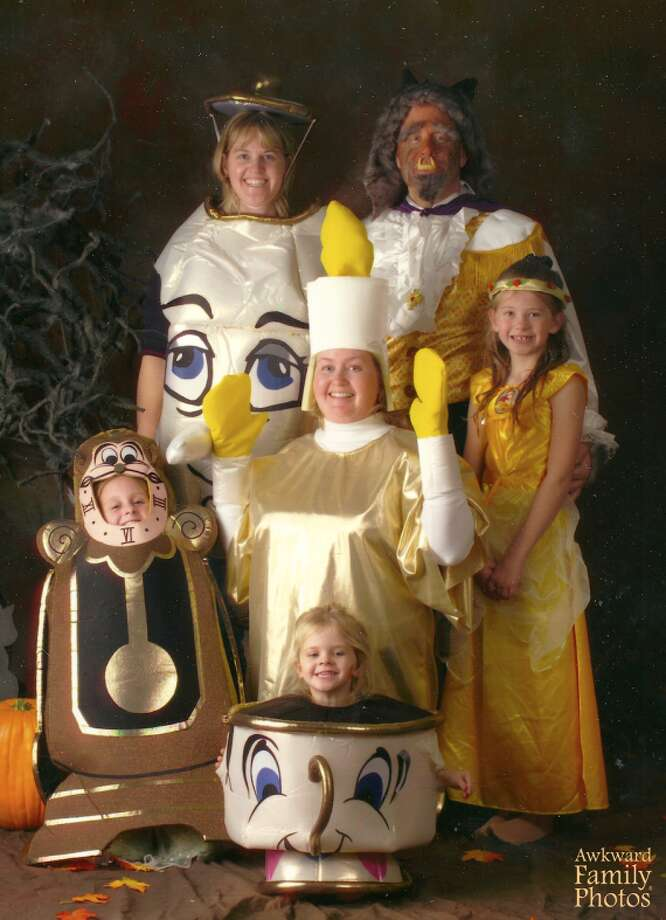 BEAUTY AND THE BEASTA family dressed as characters from 'Beauty and the Beast' bask in their glory. Photo: Awkward Family Photos
