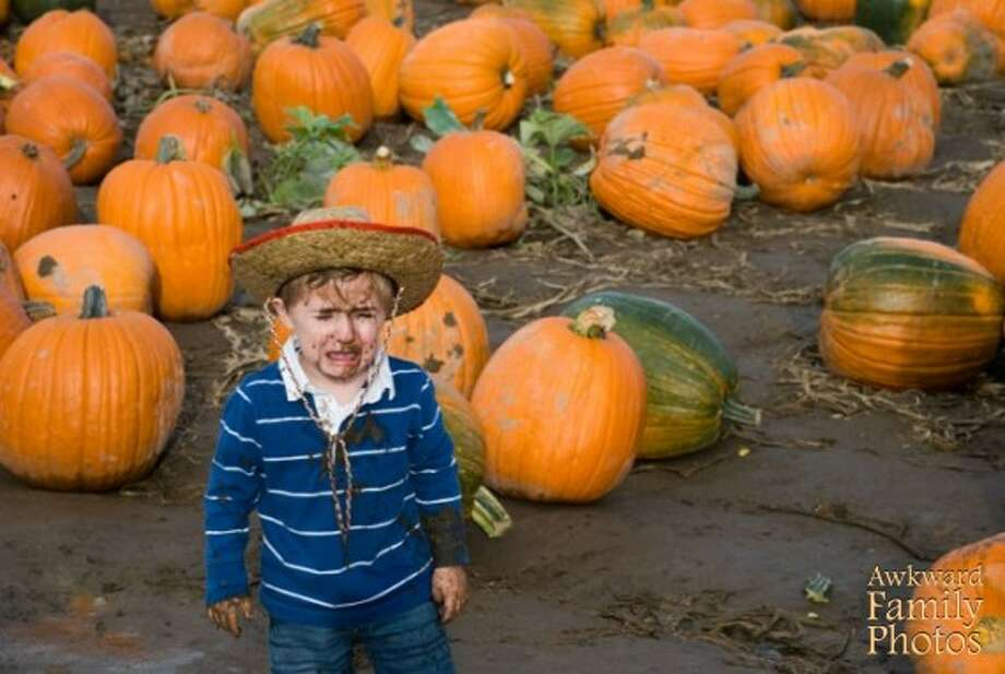 AT THE PUMPKIN PATCH He'd hoped his costume would consist of more than a stupid ol' hat! Photo: Awkward Family Photos