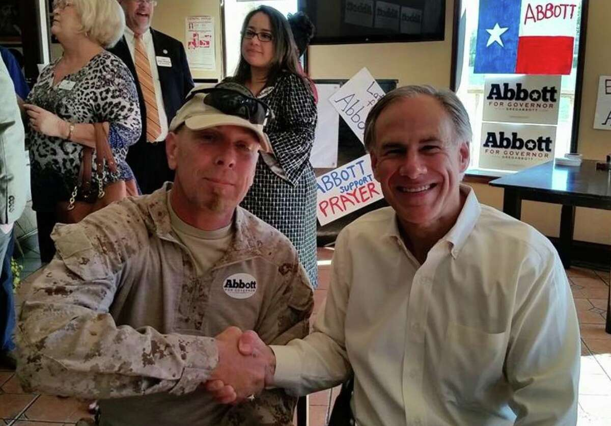 Republican gubernatorial candidate Greg Abbott is seen posing with border militia member Kevin Lyndel Massey at an Oct. 16 campaign event in Brownsville. Four days later, federal authorities arrested Massey on federal weapons charges and found a weapons cache, including ammonium nitrate, in Massey's hotel room.