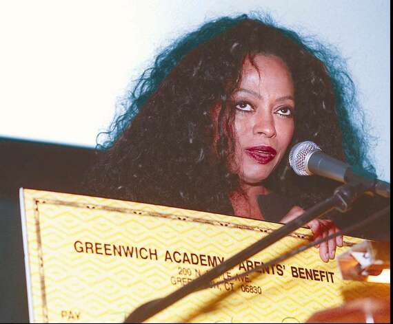 10-1-98, GREENWICH ACADEMY, Music icon, Diana Ross, accepts a check for 120,000 dollars from Greenwich Academy for a scholarship fund named after herself and daughter Chudney Ross, a graduate of Greenwich Academy class of '93, during Annual Dinner at the school. .....PHOTO/LUCKEY JR...B&W PHOTO Photo: File Photo / Greenwich Time File Photo