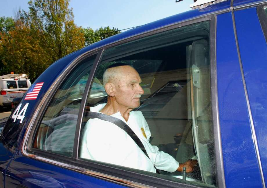 Gerardo Lombardi of 38 Nicholas Ave. in Pemberwick, sits in a Greenwich patrol car.  Lombardi is a suspect in the murder of a woman near the Pemberwick home where Lombardi lived.  Staff Photo/Bob Luckey Photo: File Photo / Greenwich Time File Photo
