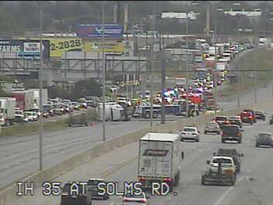 A big rig that rolled over on its side is blocking all three southbound lanes on Interstate 35 near Solms Road just south of New Braunfels.