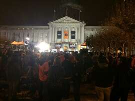 At 6:20 AM, Civic Center Plaza in San Francisco is already filling up with people waiting for the SF Giants World Series Parade.