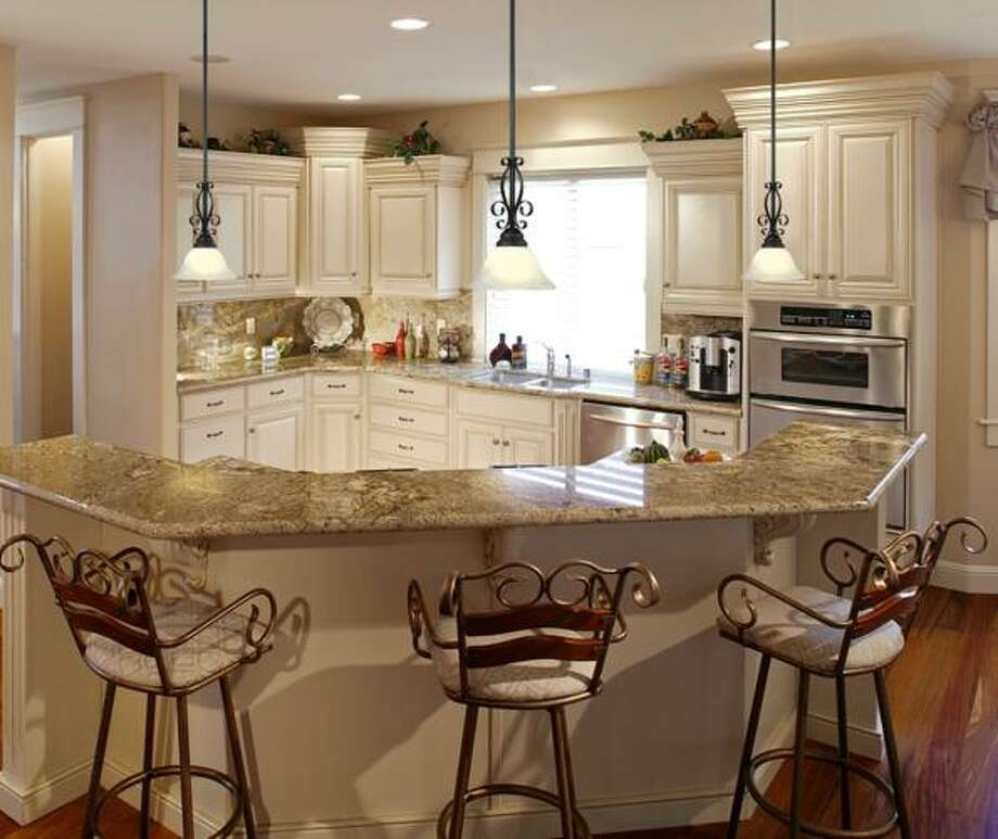 A kitchen requires particular attention to lighting for cooking, family time and entertaining. Photo: Courtesy Lamps Plus / Courtesy Lamps Plus