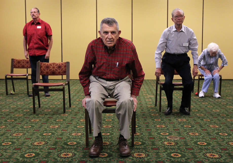 Harold Longmire (center), 88, and other residents of Morningside Ministries at the Meadows participate in a Texercise fitness class to improve strength and flexibility. Photo: JERRY LARA / Jerry Lara / San Antonio Express-News / © 2014 San Antonio Express-News