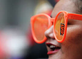 Davelle Finau, 25, sports giant orange glasses with a Giants' logo