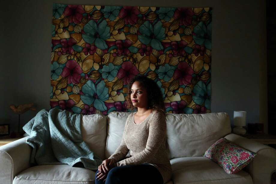 Stephanie Powers sits in her one-bedroom apartment in the Energy Corridor where she pays $850.00 for rent on Thursday, Oct. 30, 2014, in Houston. Powers has slowly been priced out of the Inner Loop where she prefers to live as opposed to the Energy Corridor.  ( Mayra Beltran / Houston Chronicle ) Photo: Mayra Beltran, Staff / © 2014 Houston Chronicle